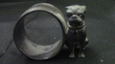 Figural napkin ring of a bulldog with a collar next to a ring