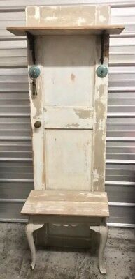 White vintage entrance way furniture. Foyer piece made from an antique door.