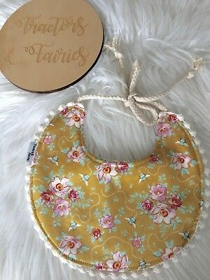 Baby girl boho bib in pink floral on mustard  by Tractors & Fairies