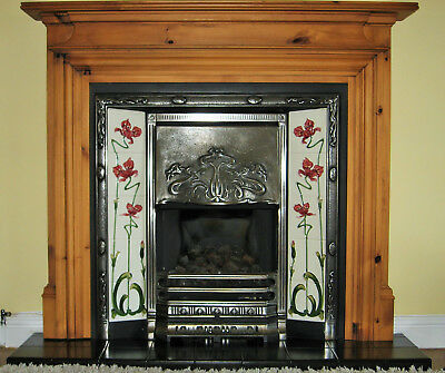 Victorian Style Cast Iron Fireplace with pine surround and  black tiled hearth