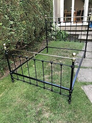 Antique brass and iron bed, standard double. Restored.