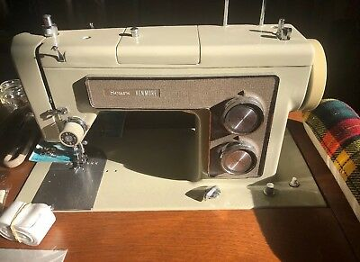 Vintage Kenmore Sewing Machine Model 1516 with sewing cabinet lots of extras!!!!