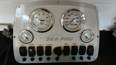 Sea Pro center console boat instrument panel with gauges and switches