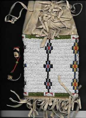 EARLY NATIVE AMERICAN MEDICINE MAN POUCH with bearclaw & carved skrimshaw