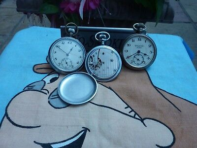 three pocket watches  all tick but sold as parts .