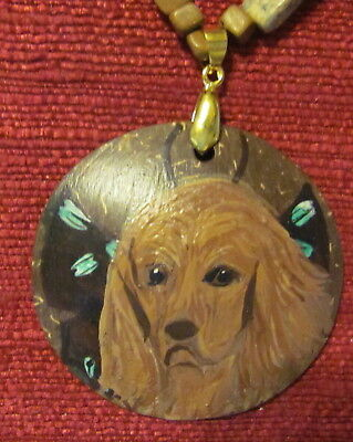 "Sussex Spaniel hand painted on a 2"", convex pendant/bead created from a coconut"