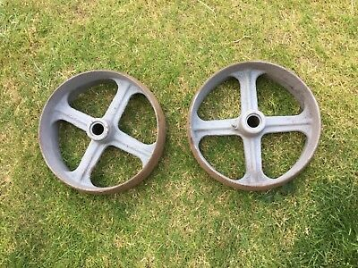 Two identical cast iron wheels