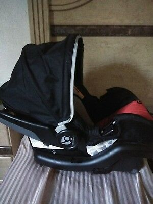 Red and Black Brand-New Infant Carseat With Base Never Been used.
