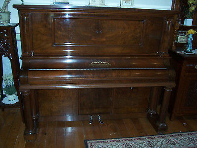 Gulbransen player piano.Nice condition. Smart cabinet to match. Rolls included.