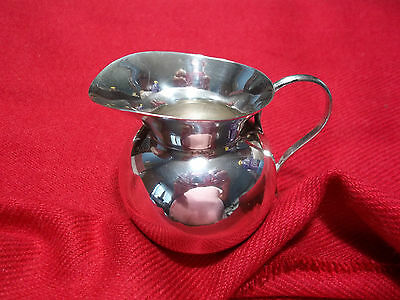 """sterling Creamer. Made in Mexico. 2X2 """" 46 solid grams."""