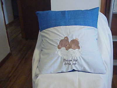 Blue pocket pillow with bear on cloud text Dream big little one