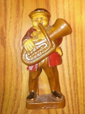 Antigue wooden figure. Tuba umpah-pah band player