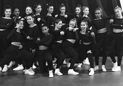Black harem pants and cropped tops. Dance Team Costumes for 14 dancers.