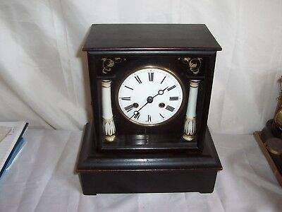 Beautiful French Ebonised Time And Strike Mantle Clock With Silk Suspension..