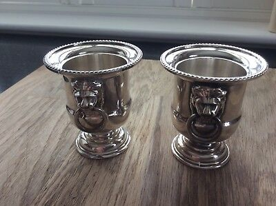 A Maching Pair Of Miniture Urns. Silver Plated.