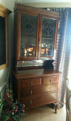 Antique dresser ,two coloured leaded glass doors..three deep drawers