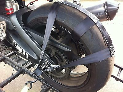 Rear wheel tie down straps supports transporting motorbike on trailor or van