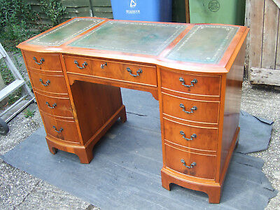 A pretty yew wood antique reproduction yew wood desk green leather
