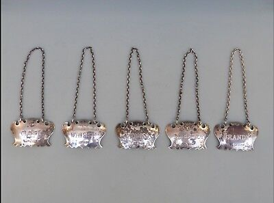 A Set Of solid silver Decanter Labels (5)
