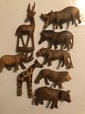 8 Miniature African Animals. Made Out of Wood. Beautiful to display in any room.