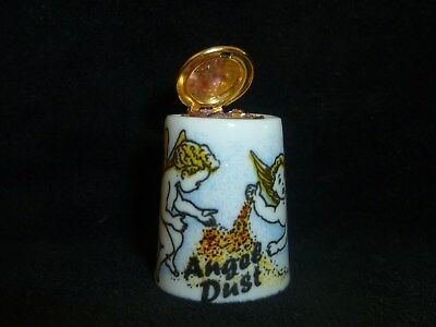 Birchcroft Angel dust thimble with lid that opens containing pinkglitter