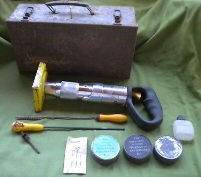 Tornado vintage nail/spit gun, with original steel case, key, cartridges