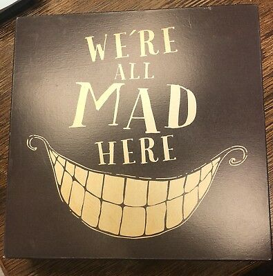 We're All Mad Here Sign