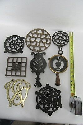 Lot of 8 assorted Brass, Iron, and Cast Iron Trivets/Iron Rests, some Antique.