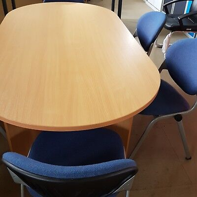 Brand New boardroom table with 6 free used chairs.