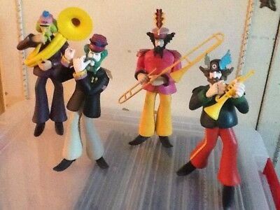 FOUR BEATLES FIGURES BY McFARLANE TOYS