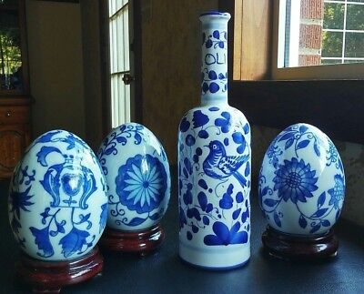Vintage Italian Blue & White floral porcelain vase and 3 eggs with stands.