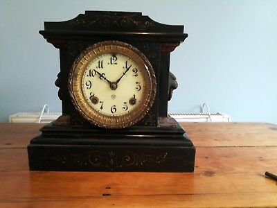American cast iron mantle clock.