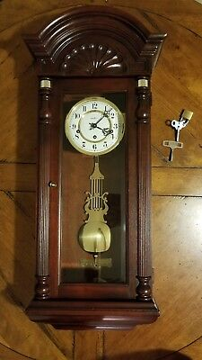 Vintage Howard Miller Jennison Wall Clock Chiming With Keys and Mahogany