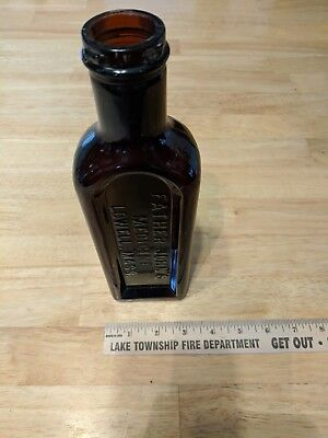 Antique Vintage Embossed Glass Father John's Medicine Lowell, Mass Brown Bottle