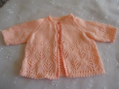 New hand knitted peach baby girl's cardigan lacy design age 0-3 mths