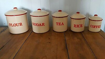 set of enamel kitchen canisters vintage style