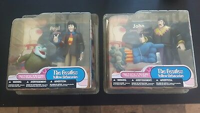 4 beatles figurines and book
