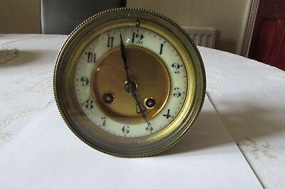 Antique French type clock movement, bezel and glass in good condition.