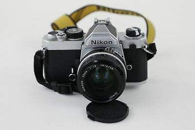 NIKON Fm 2638092 with Nikon Nikkor 1:1-8 50mm Lens - Appears to be Working