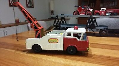 Antique tin toy tow truck