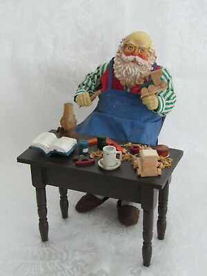 Clothtique Possible Dreams Santa Claus on Chair Working at Workbench 1989