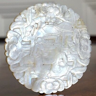 A Finely Carved Chinese Mother Of Pearl Gaming Counter In High Relief, c.1860.