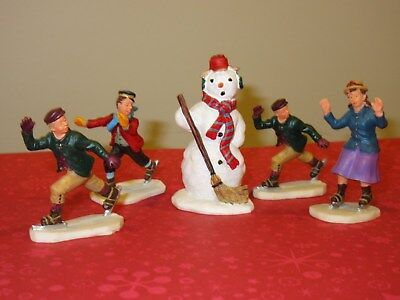 LEMAX Christmas Village Snowman and Ice Skating Skater Figurines