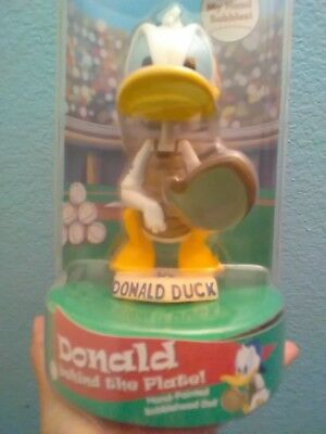Dodger/Disney collectable bobbleheads, Donald Duck, Goofy, Poppeye the sailo