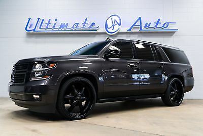 "Chevrolet Suburban Premier 26"" MHT Wheels. 2/3"" Lowering Kit. JL Audio Bass Package. Gloss Black Ext Trim."