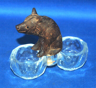 A well carved antique Victorian Black Forest sitting bear figure, with salt dish