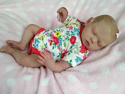 Beautiful Reborn Baby Doll painted hair . Wow great price! Can be rooted