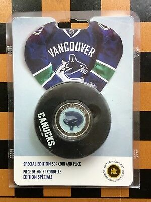 2009 CANADA NHL VANCOUVER CANUCKS 50 cent  COIN AND PUCK SPECIAL EDITION-No Tax