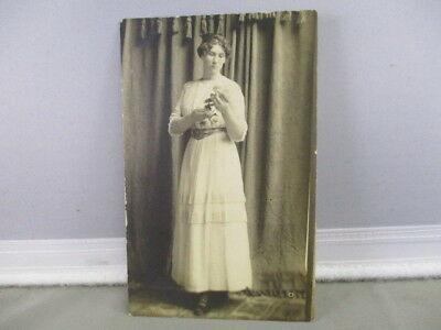 Rppc Portrait Young  Woman Contemplating The Flower She Is Holding