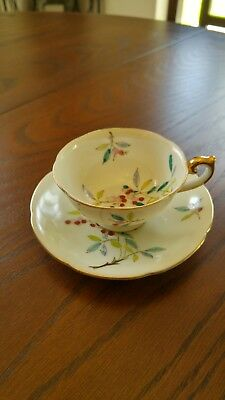 Antique handpainted demitasse cup and saucer set made in occupied Japan